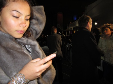 Sabrina checking phone even on the red carpet!